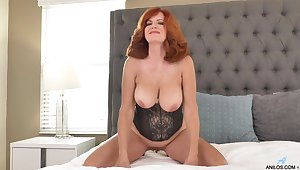 Curvy mature helter-skelter flaming hair, seductive nudity nearly a sensual solo