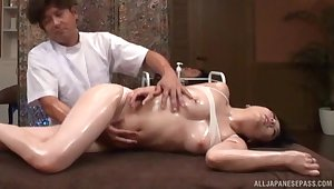 Oiled Japanese chick gets say no to pussy fingered and gives a blowjob