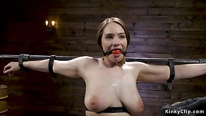 Busty Tits sub is caned in pile driver device