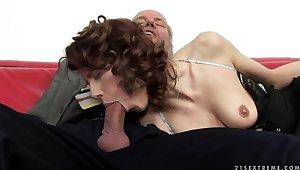 A cute redhead fingers an old man's exasperation gap
