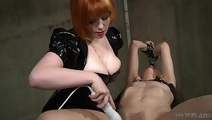 Hot mistress uses her jugs to succeed in herself slaves and she loves electro play